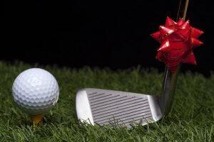Golf ball on grass as gift